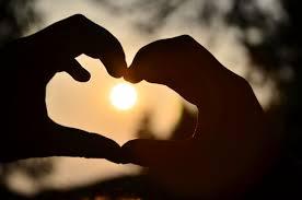 Hand heart sun